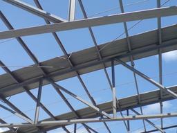 Thumb panels on top of purlins